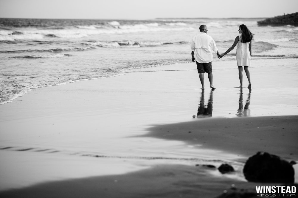 Romantic engagement photo at the beach in Wilmington, NC.