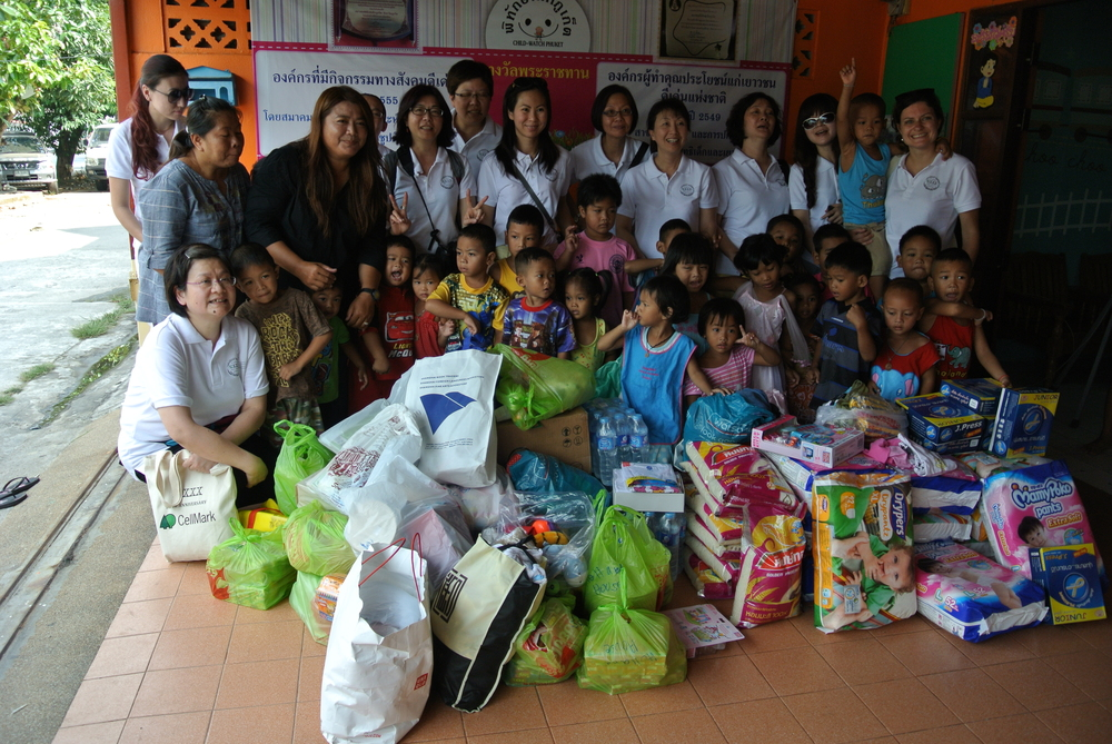 The Singapore team with the essentials and other supplies they gathered for SOS Children's Village