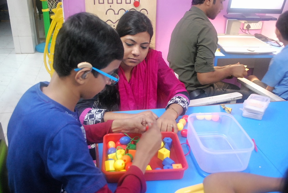 Student working with an aide at Muskan Therapy Center.