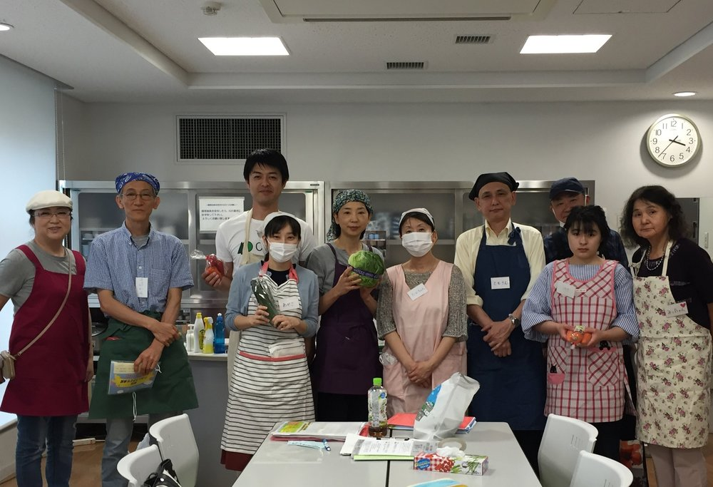 "Members of PaperSeed japan alongside other volunteers making dinner with the charity ""Children's Dinner"" for PaperSeed Day 2017"
