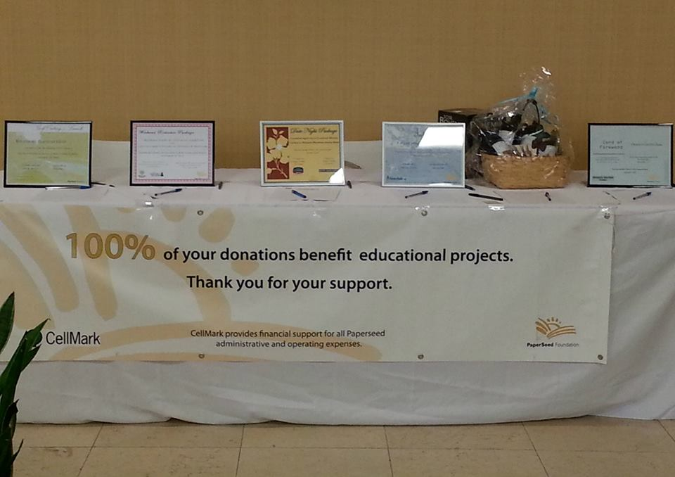 The silent auction table at the Feed the Need fundraiser
