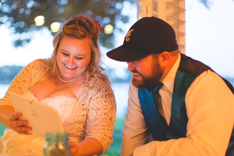 Outdoor Southern Wedding | bride and groom viewing their wedding day slideshow