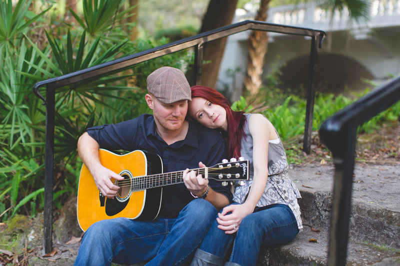 Outdoor Orlando Engagement Session | He plays his guitar for her