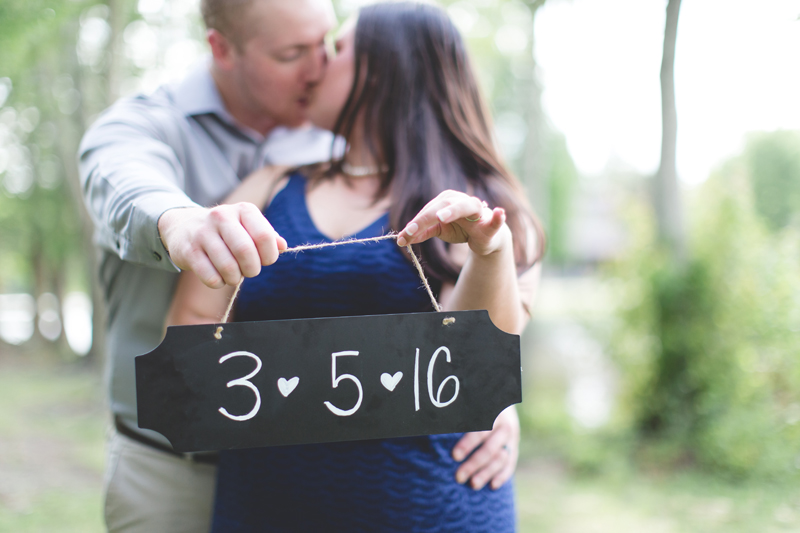 save the date photo chalkboard couple holding save the date sign lakeland lake parker park engagement photos