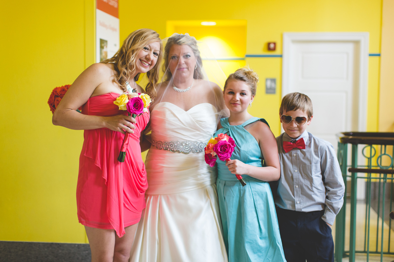 orange county regional history center intimate wedding bride with sister and young groomsmen