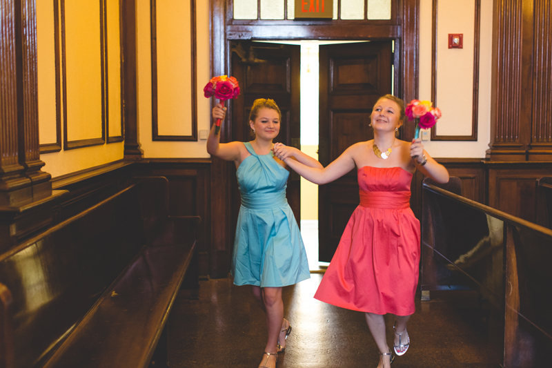 orange county regional history center intimate wedding young bridesmaids dacing down the aisle