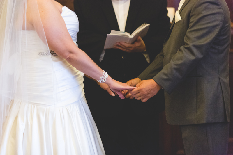 orange county regional history center intimate wedding bride and groom holding hands during ceremony
