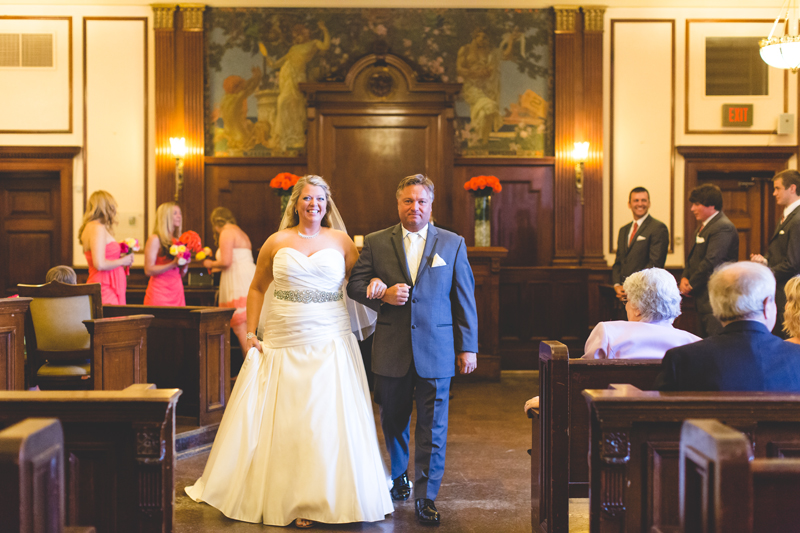 orange county regional history center intimate wedding bride and groom walking down aisle after ceremony in old courtroom