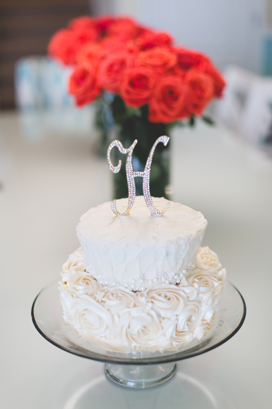 orange county regional history center intimate wedding white wedding cake with coral roses