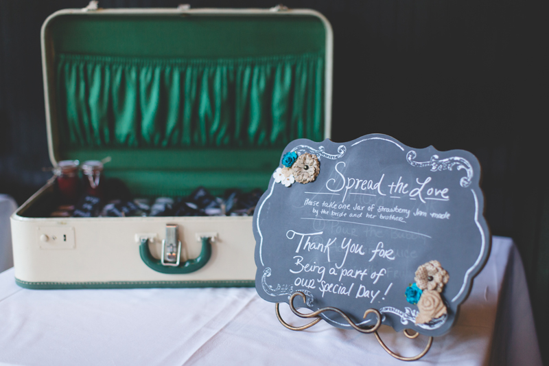 66 vintage suitcase filled with homemade jelly wedding recption orlando outdoor wedding photographer 310 lakeside wedding cj-250.jpg
