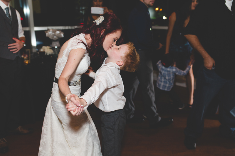 91 bride dancing with her son bride kissing young son orlando outdoor wedding photographer 310 lakeside wedding cj-771.jpg