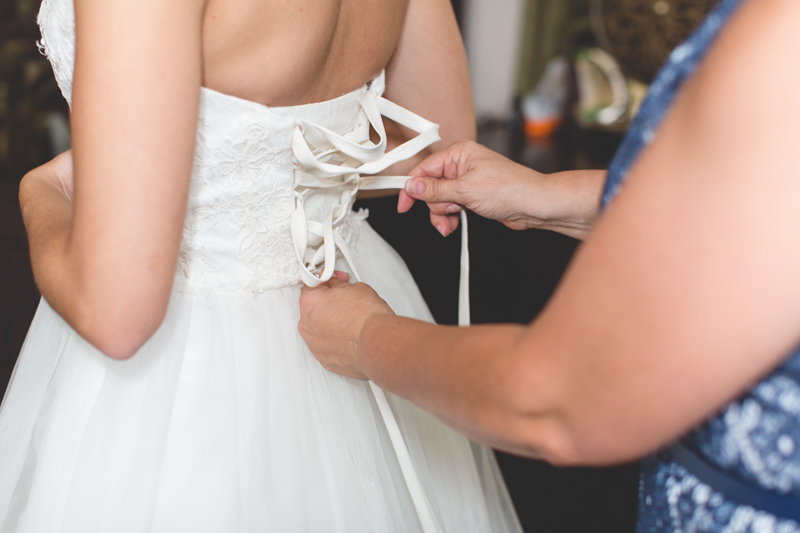 intimate wedding in a house - bride getting dressed