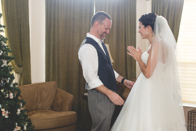 intimate wedding in a house - bride and groom first look