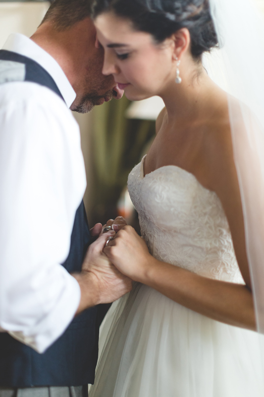 intimate wedding in a house - bride and groom pray