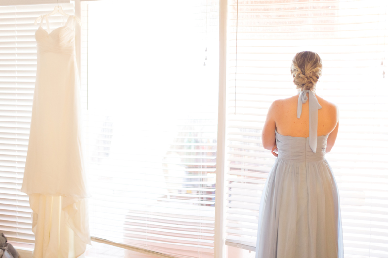 Bridesmaid getting ready - wedding dress hanging up - Beach Wedding Photos - destination Orlando wedding photographer - Jaime DiOrio