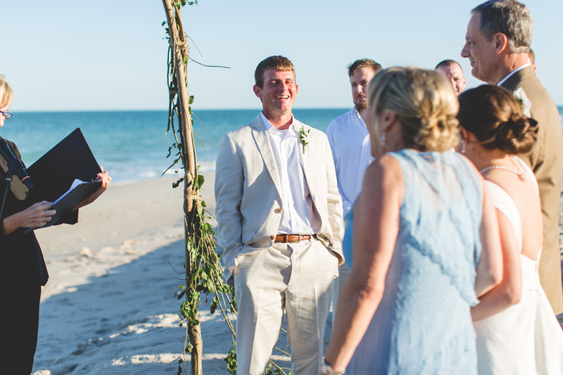 Groom sees Bride walking down aisle - Beach Wedding Photos - destination Orlando wedding photographer - Jaime DiOrio