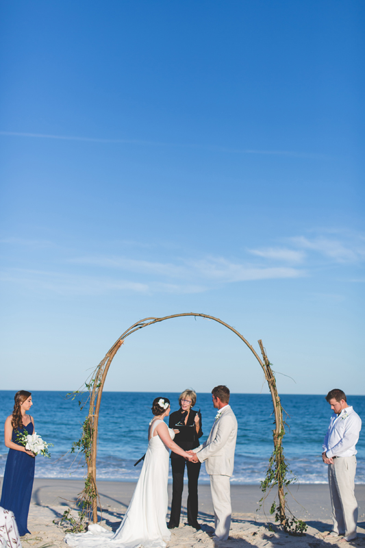 Bride and Groom with ocean - Beach Wedding Photos - destination Orlando wedding photographer - Jaime DiOrio