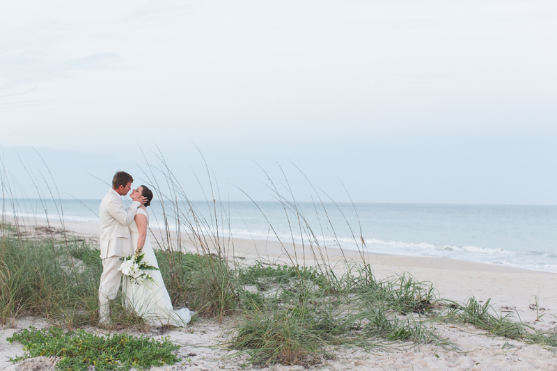 Bride and Groom on Beach - Beach Wedding Photos - destination Orlando wedding photographer - Jaime DiOrio