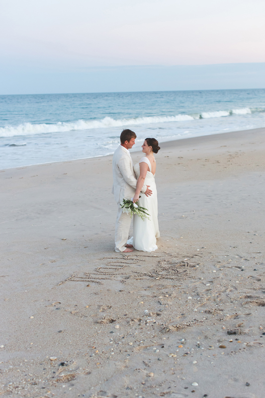Bride and Groom on Beach with sunset - Beach Wedding Photos - destination Orlando wedding photographer - Jaime DiOrio