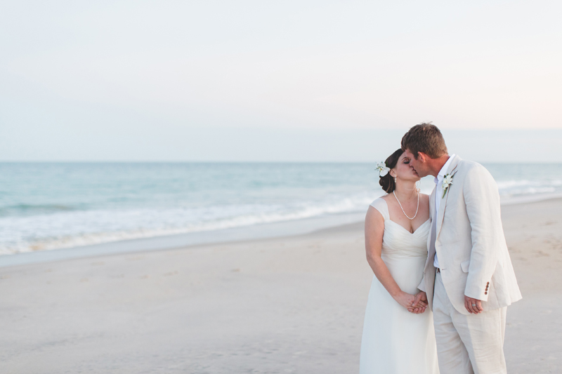 Bride and Groom kissing on beach - Beach Wedding Photos - destination Orlando wedding photographer - Jaime DiOrio