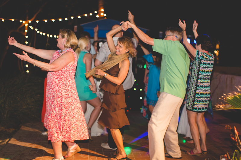 Guests dancing at reception - Beach Wedding Photos - destination Orlando wedding photographer - Jaime DiOrio