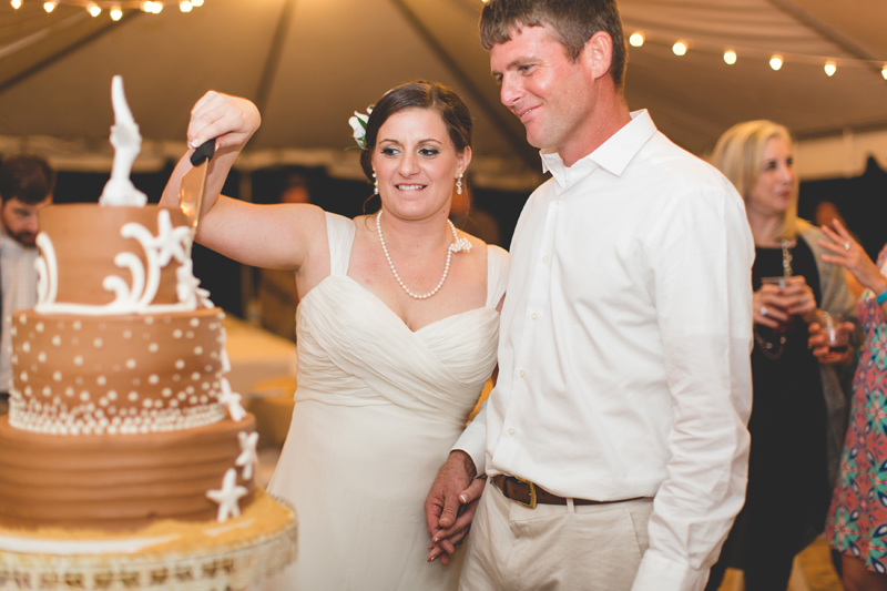 Bride and Groom cutting cake - Beach Wedding Photos - destination Orlando wedding photographer - Jaime DiOrio