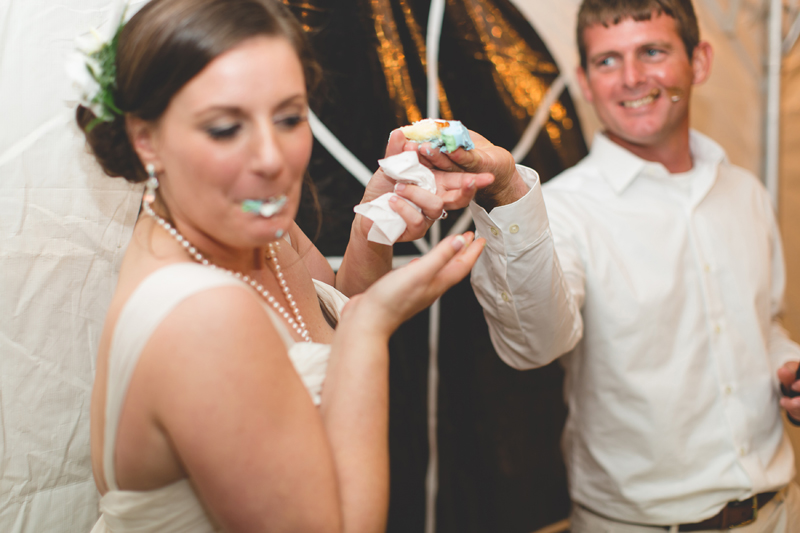 Groom shoving cake in Brides face - Beach Wedding Photos - destination Orlando wedding photographer - Jaime DiOrio