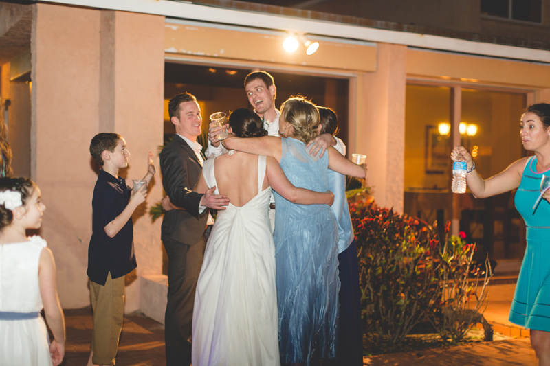 Family Group hug at wedding - Beach Wedding Photos - destination Orlando wedding photographer - Jaime DiOrio