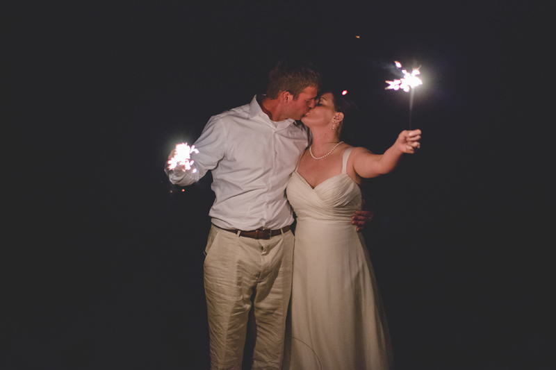 Bride and Groom with sparklers - Beach Wedding Photos - destination Orlando wedding photographer - Jaime DiOrio