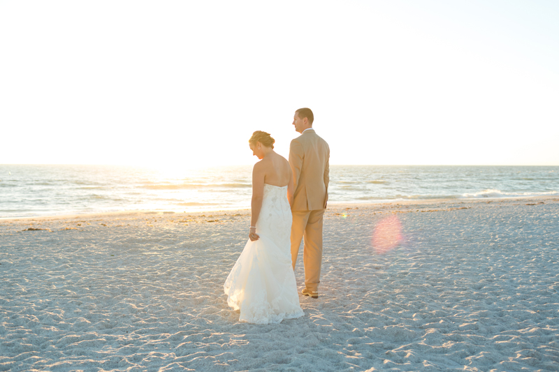 Bride and Groom walking on beach - Tradewinds Island Grand Resort beach wedding - st pete beach - Jaime DiOrio Photography - Destination Orlando wedding photographer -  (55).JPG