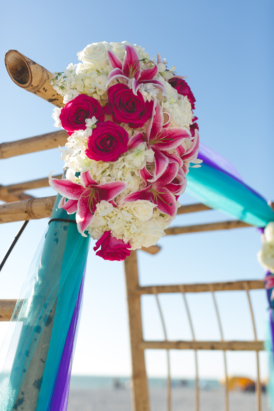 Ceremony bamboo arch with flowers - Tradewinds Island Grand Resort beach wedding - st pete beach - Jaime DiOrio Photography - Destination Orlando wedding photographer -  (36).JPG