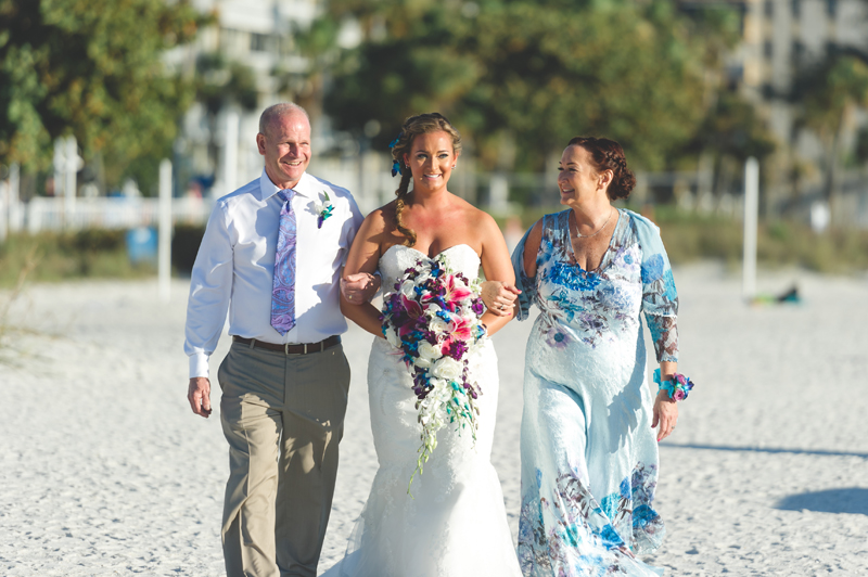 Bride walking down aisle with mom and dad - Tradewinds Island Grand Resort beach wedding - st pete beach - Jaime DiOrio Photography - Destination Orlando wedding photographer -  (42).JPG