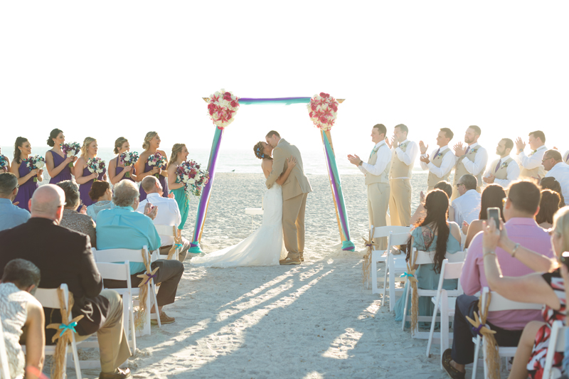 First kiss at beach ceremony - Tradewinds Island Grand Resort beach wedding - st pete beach - Jaime DiOrio Photography - Destination Orlando wedding photographer -  (47).JPG