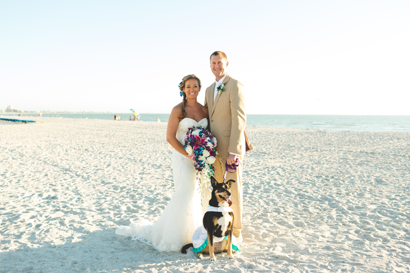 Bride and Groom portrait with dog - Tradewinds Island Grand Resort beach wedding - st pete beach - Jaime DiOrio Photography - Destination Orlando wedding photographer -  (49).JPG