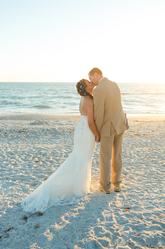 Bride and Groom beach kissing - Tradewinds Island Grand Resort beach wedding - st pete beach - Jaime DiOrio Photography - Destination Orlando wedding photographer -  (56).JPG