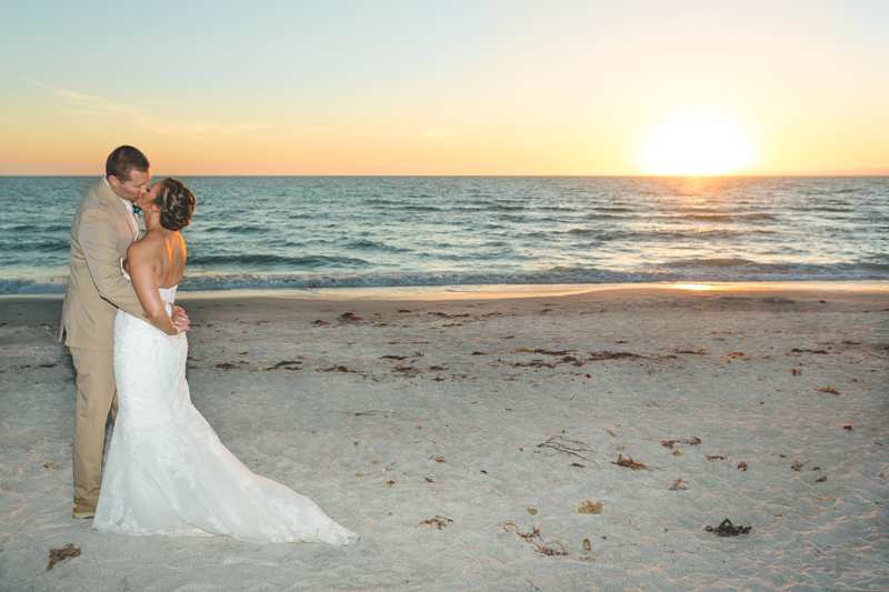 Bride and Groom kissing at sunset on the beach photo - Tradewinds Island Grand Resort beach wedding - st pete beach - Jaime DiOrio Photography - Destination Orlando wedding photographer -  (59).JPG