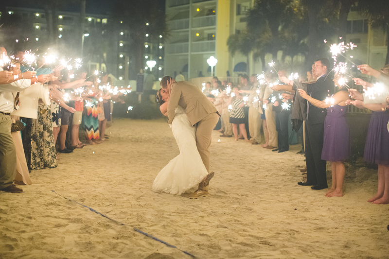 Sparkler Exit at wedding - bride and groom kissing - Tradewinds Island Grand Resort beach wedding - st pete beach - Jaime DiOrio Photography - Destination Orlando wedding photographer -  sparkler exit.JPG