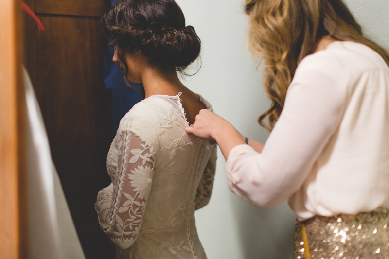 Bride getting ready with bridesmaid - bohemian inspired outdoor wedding at Mission Inn Resort - howey in the hills fl - destination orlando wedding photographer - Jaime DiOrio (7).jpg