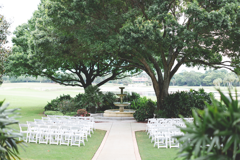 ceremony with huge oak trees and fountain - bohemian inspired outdoor wedding at Mission Inn Resort - howey in the hills fl - destination orlando wedding photographer - Jaime DiOrio (47).jpg