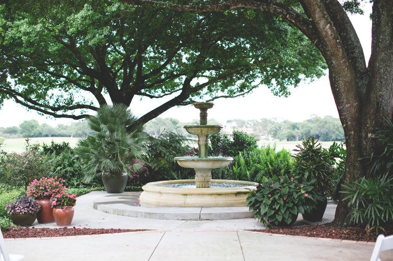 Ceremony fountain under trees - bohemian inspired outdoor wedding at Mission Inn Resort - howey in the hills fl - destination orlando wedding photographer - Jaime DiOrio (49).jpg