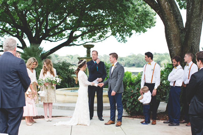 Ring exchange between Bride and Groom - bohemian inspired outdoor wedding at Mission Inn Resort - howey in the hills fl - destination orlando wedding photographer - Jaime DiOrio (58).jpg