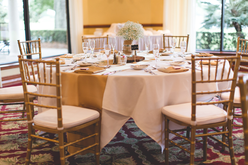 Round reception table with gold - bohemian inspired outdoor wedding at Mission Inn Resort - howey in the hills fl - destination orlando wedding photographer - Jaime DiOrio (25).jpg