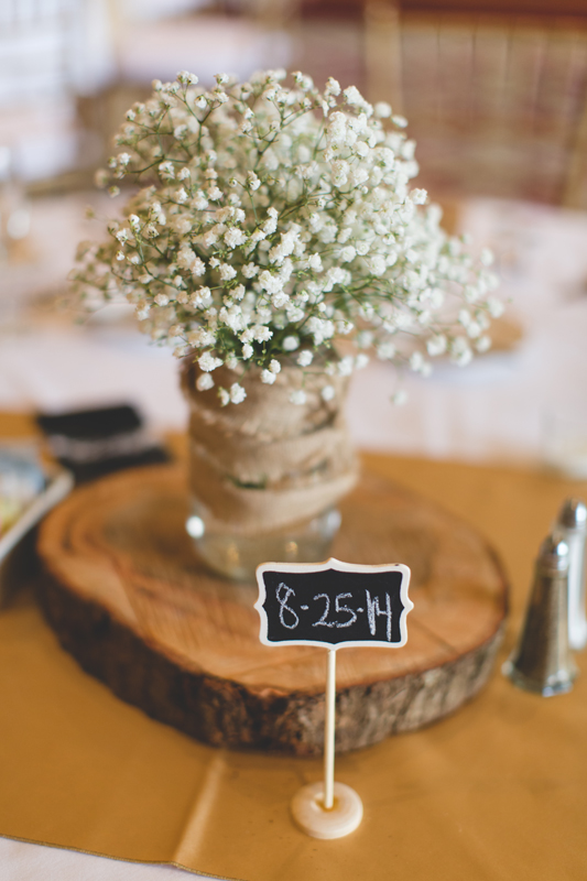 Babies breath centerpiece on tree stump with mason jar - bohemian inspired outdoor wedding at Mission Inn Resort - howey in the hills fl - destination orlando wedding photographer - Jaime DiOrio (26).jpg