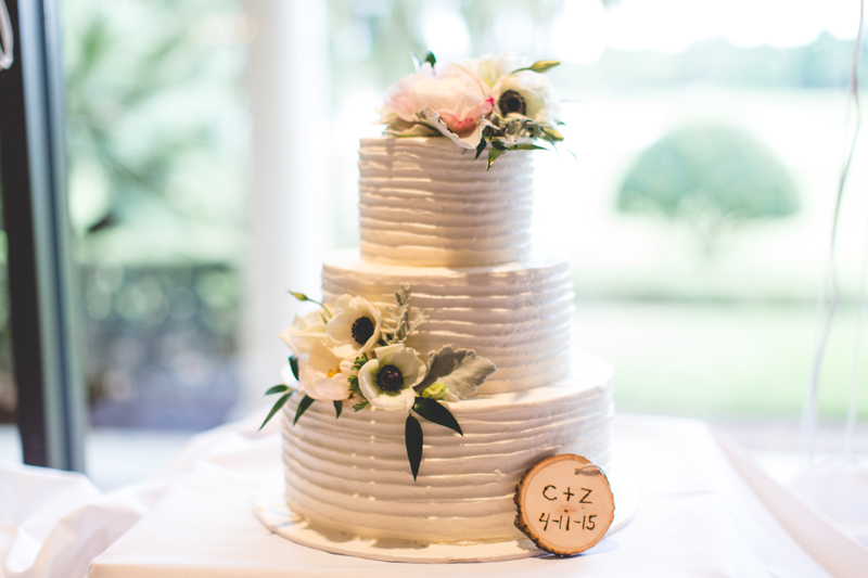 Wedding cake with anemones - bohemian inspired outdoor wedding at Mission Inn Resort - howey in the hills fl - destination orlando wedding photographer - Jaime DiOrio (28).jpg