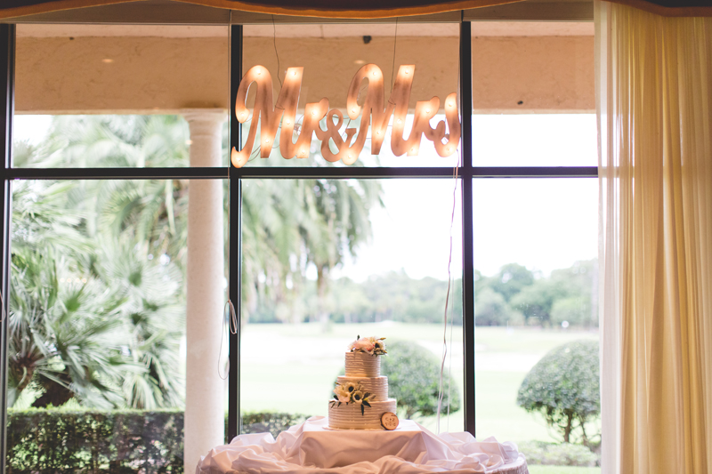 Mr and Mrs light up sign over cake table - bohemian inspired outdoor wedding at Mission Inn Resort - howey in the hills fl - destination orlando wedding photographer - Jaime DiOrio (34).jpg