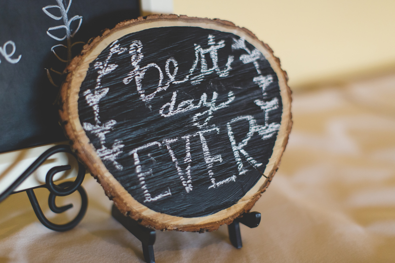 best day ever chalkboard paint on tree stump - bohemian inspired outdoor wedding at Mission Inn Resort - howey in the hills fl - destination orlando wedding photographer - Jaime DiOrio (40).jpg