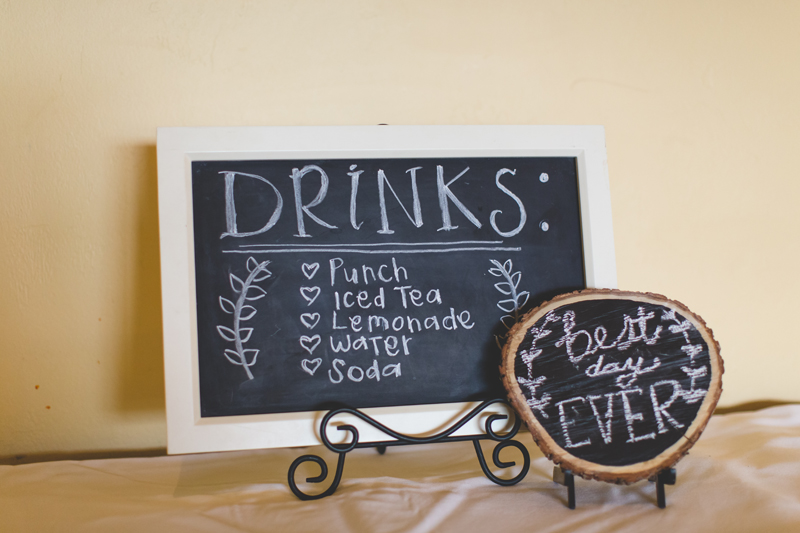 Wedding reception drinks chalkboard sign - bohemian inspired outdoor wedding at Mission Inn Resort - howey in the hills fl - destination orlando wedding photographer - Jaime DiOrio (39).jpg