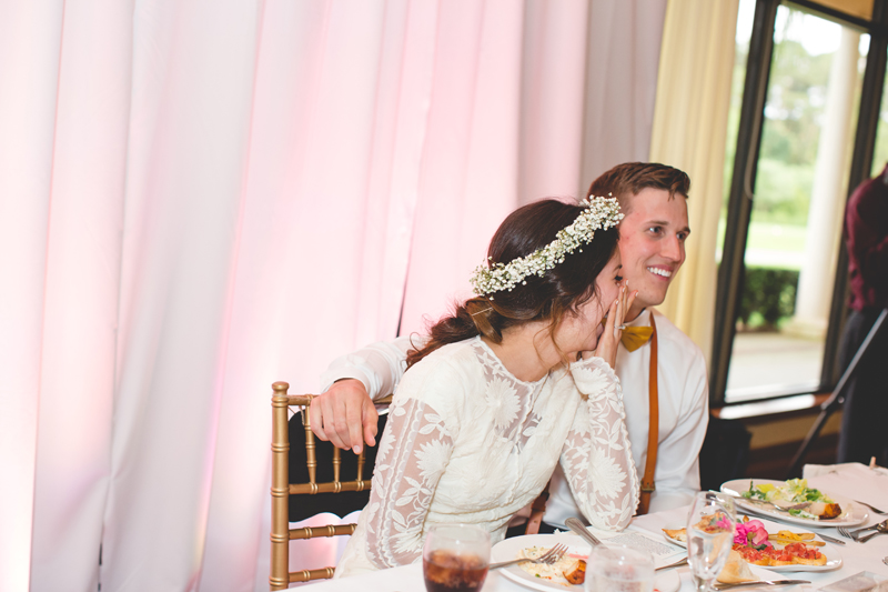 Bride and Groom laughing at reception - bohemian inspired outdoor wedding at Mission Inn Resort - howey in the hills fl - destination orlando wedding photographer - Jaime DiOrio (66).jpg