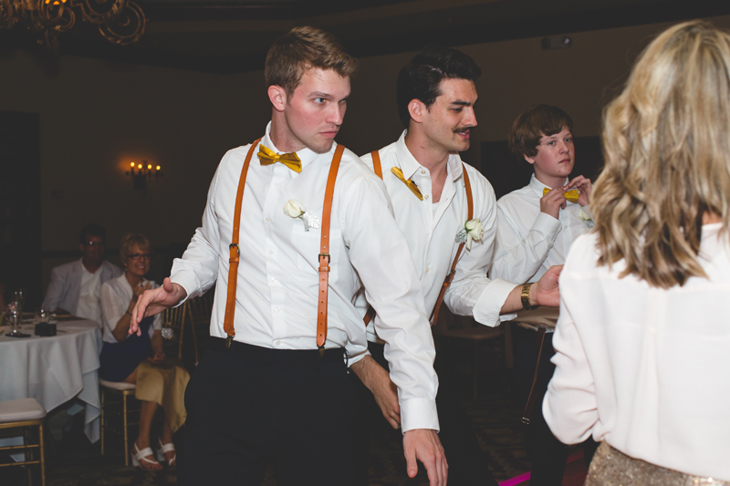 Groomsmen dancing at reception - bohemian inspired outdoor wedding at Mission Inn Resort - howey in the hills fl - destination orlando wedding photographer - Jaime DiOrio (69).jpg