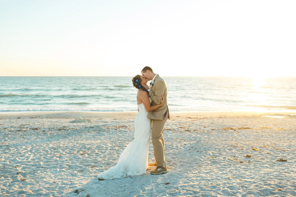 Jaime DiOrio - Destination Orlando Wedding Photographer - bride and groom kissing on beach - Tradewinds Resort Wedding.jpg